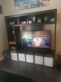black wooden TV hutch with flat screen television Langley, V1M