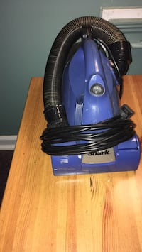 blue and black canister vacuum cleaner North Augusta, 29841