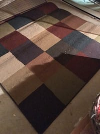 black, brown, and red area rug 533 km