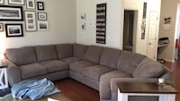 brown suede sectional couch with throw pillows Clarksville, 37042
