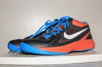 pair of black-and-blue Nike running shoes Winnipeg, R3M