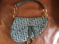 black and gray Coach leather hobo bag