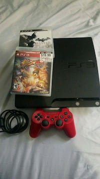 black Sony PS3 slim console with controller and ga 52 mi
