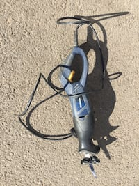 black and gray corded angle grinder 534 km