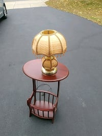 small accent table with magazine rack and lamp