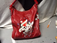 red and white leather hobo bag