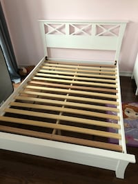White solid wood double bed In excellent condition.