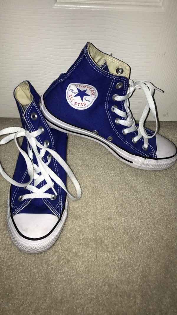 Pair of blue converse all star high-top sneakers