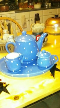 white-and-blue polka-dot ceramic teapot