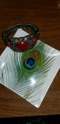 silver-colored bracelet with red gemstone 66 km