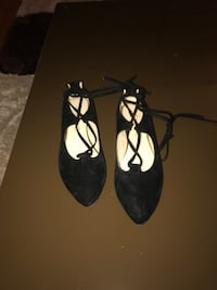 Women's pair of black suede pointed flats