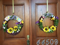 two green-yellow-and-purple floral wreaths