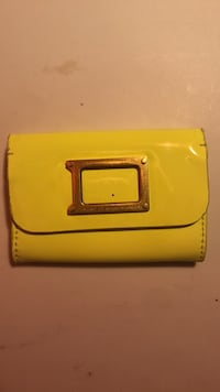 yellow and black leather wallet 57 km