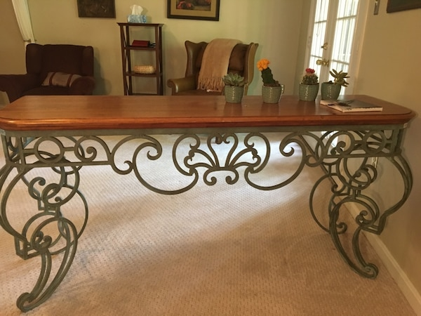 Wood and green rod iron sofa table. Moving sale best offer. 27053672-87b6-414a-bcb0-a2ac33850f07