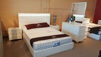 white wooden bed with white mattress