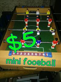 green and blue foosball table