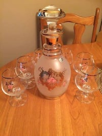 Bohemia carafe with set of 6 glass gold trim. A must see.