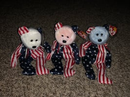 Four assorted color animal plush toys