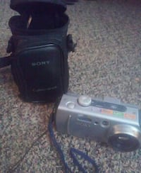 gray Sony compact camera with bag