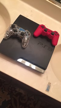 Black sony ps3 slim  2 controllers works perfect not damage Alexandria, 22315
