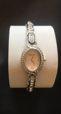 Round silver-colored analog watch with link bracelet 547 km