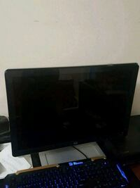 black flat screen TV with remote Springfield, 22153
