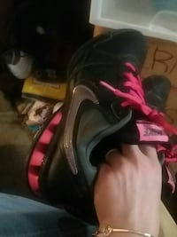 black, gray, and pink Nike running shoes