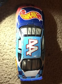 blue and red Hot Wheels die cast model