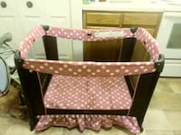baby's black and pink travel cot Frederick