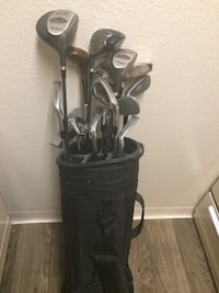 Full set of McGregor PowerShot irons and woods with a few extra drivers and specialty club sandwich pitching wedge as well as in Dunlap potter