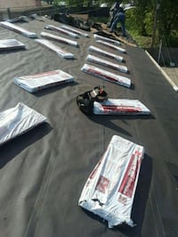 Roof repair gutters siding soffit Windows tuckpoin Chicago