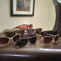 four assorted sunglasses with cases 3490 km