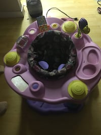 baby's purple and pink activity saucer