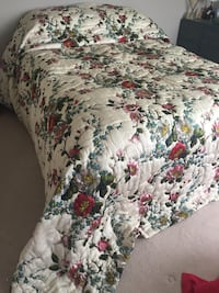White, red, and green floral bedspread 525 km
