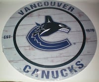 Vancouver Canucks Weathered Circle Wood Plaque