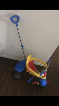 toddler's yellow, red, and blue push pedal trike Las Vegas, 89123
