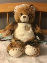 Brown and white build-a-bear with sound