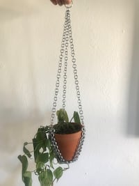 """Handmade chainmail flower pot hanger. Measurements are approximately L: 19 1/2"""" Bottom base W: 3"""". Will fit small and most medium plant pots. Madison, 53704"""