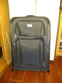 "JOSEPH ABBOUD 20"" EXPANDABLE CARRY-ON 360 SPINNER  1187 mi"