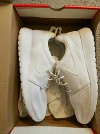 pair of white Nike Roshe running shoes with box