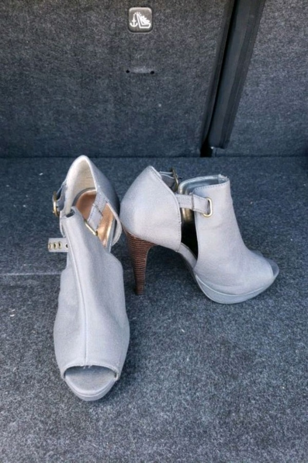 pair of grey leather open toe ankle strap heels