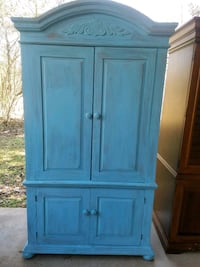 blue wooden 2-door cabinet