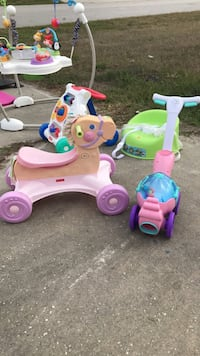 toddler's white and pink ride on toy Deltona, 32738