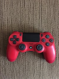 red Sony PS4 dualshock controller