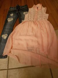 pink sleeveless button-up midi dress with black-washed jeans