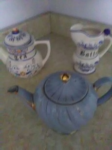 white and blue ceramic teapots