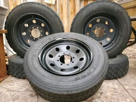 Ford F250 tires, rims, and side rails