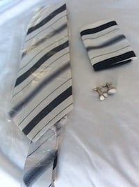 white and black stripe necktie and pair of silver-colored cufflinks 3/10$