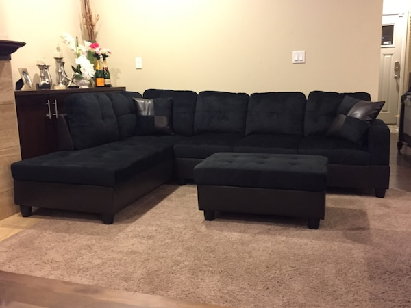 Black microfiber sectional couch and ottoman