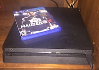 black Sony PS4 console with controller and Madden 18